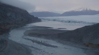 AK0001_0048 - 4K stock footage aerial video flying low over river flowing into lake, near glacier, Knik, Alaska