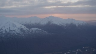 AK0001_0085 - 4K stock footage aerial video flying over Eagle River, revealing Chugach Mountains, Eagle River, Alaska, sunset