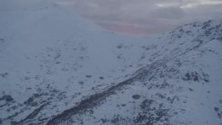 AK0001_0089 - 4K stock footage aerial video approaching summit of Chugach Mountains, Alaska, sunset