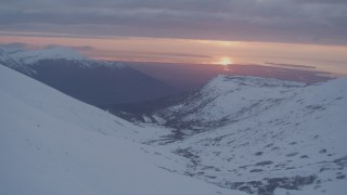 AK0001_0091 - 4K stock footage aerial video approaching Anchorage, seen from Chugach Mountains, Alaska, sunset