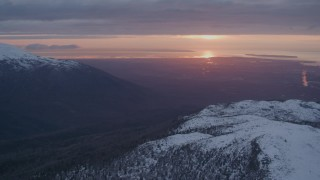AK0001_0093 - 4K stock footage aerial video pan left by Anchorage, seen from Chugach Mountains, Alaska, sunset