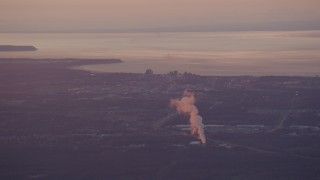 AK0001_0095 - 4K stock footage aerial video a power plant and Downtown Anchorage, Alaska, sunset