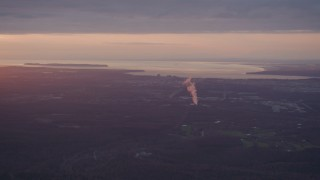 AK0001_0096 - 4K stock footage aerial video approaching Anchorage and a power plant, Alaska, sunset