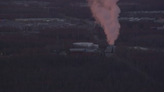 AK0001_0099 - 4K stock footage aerial video approaching a power plant, Anchorage, Alaska, sunset