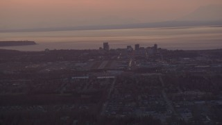 AK0001_0101 - 4K stock footage aerial video approaching Merrill Field and Downtown Anchorage, Alaska, sunset