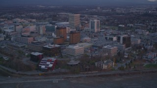 AK0001_0107 - 4K stock footage aerial video orbiting hotels, revealing Downtown Anchorage, Alaska, twilight