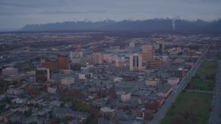 AK0001_0108 - 4K stock footage aerial video orbit Downtown, Chugach Mountains, Downtown Anchorage, Alaska, twilight
