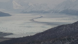 AK0001_0110 - 4K stock footage aerial video glacier, bordered by Chugach Mountains, Knik Glacier, Alaska