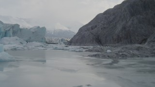 AK0001_0116 - 4K stock footage aerial video flying low over icy Knik River, tilt up, revealing Knik Glacier, Alaska