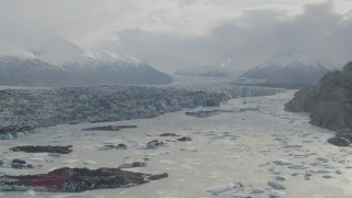 AK0001_0120 - 4K stock footage aerial video descending towards Knik River, Chugach Mountains and Knik Glacier, Alaska