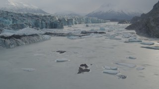AK0001_0121 - 4K stock footage aerial video flying low over icy Knik River, near Knik Glacier, Alaska