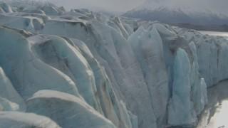 AK0001_0124 - 4K stock footage aerial video flying over Knik River, approaching edge of Knik Glacier, Alaska