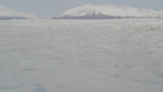 AK0001_0132 - 4K stock footage aerial video flying low over Knik Glacier, approaching Chugach Mountains, Knik Glacier, Alaska