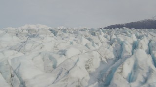 AK0001_0133 - 4K stock footage aerial video flying low over Knik Glacier, approach Chugach Mountains, Knik Glacier, Alaska