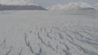 AK0001_0142 - 4K stock footage aerial video fly over surface of Knik Glacier, reveal Chugach Mountains, Knik Glacier, Alaska