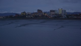 AK0001_0154 - 4K stock footage aerial video flying over Knik Arm of Cook Inlet approaching Downtown Anchorage, Alaska, night