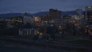 AK0001_0155 - 4K stock footage aerial video flying along the shore, by Downtown Anchorage, Alaska, night