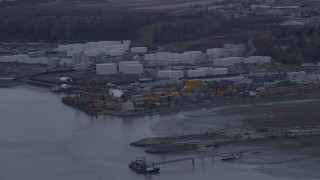 AK0001_0165 - 4K stock footage aerial video flying by an oil refinery, shore of the Knik Arm of Cook Inlet, Anchorage, Alaska