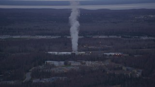 AK0001_0183 - 4K stock footage aerial video flying by a power plant, Anchorage, Alaska, twilight