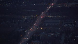AK0001_0193 - 4K stock footage aerial video flying over Debarr Road, revealing Merrill Field, Anchorage, Alaska, night