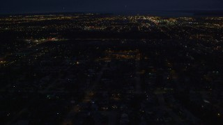 AK0001_0195 - 4K stock footage aerial video approaching downtown buildings, Anchorage, Alaska, night