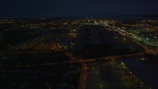 AK0001_0197 - 4K stock footage aerial video approaching Merrill Field, landing aircraft, Anchorage, Alaska, night