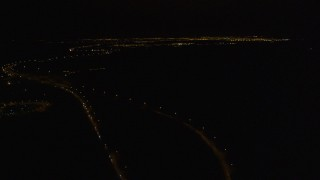 AK0001_0202 - 4K stock footage aerial video following Glenn Highway, Eagle River, Alaska, night