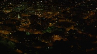 AK0001_0208 - 4K stock footage aerial video flying by Hotel Captain Cook, tilt up to reveal Downtown Anchorage, Alaska, night