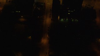 AK0001_0210 - 4K stock footage aerial video of a bird's eye view of city streets in Downtown Anchorage, Alaska, night