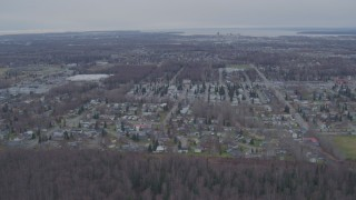 AK0001_0242 - 4K stock footage aerial video flying over mobile home park, approaching Downtown Anchorage, Alaska