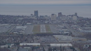 AK0001_0243 - 4K stock footage aerial video approaching Merrill Field, Downtown buildings, Anchorage, Alaska