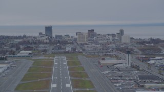 AK0001_0245 - 4K stock footage aerial video approaching Merrill Field, quick zoom to Downtown buildings, Anchorage, Alaska