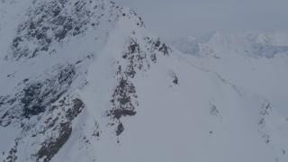AK0001_0264 - 4K stock footage aerial video approaching snowy peak, valley, Chugach Mountains, Alaska