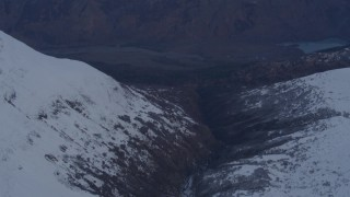 AK0001_0266 - 4K stock footage aerial video following river, revealing deep valley, Chugach Mountains, Alaska