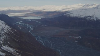 AK0001_0279 - 4K stock footage aerial video flying over a river valley, pan right to reveal a glacier, Inner Lake George, Alaska