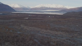 AK0001_0281 - 4K stock footage aerial video flying low over the river valley, approaching Inner Lake George, Alaska