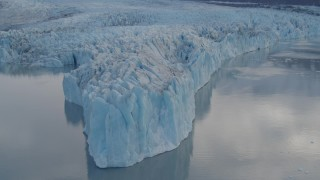 AK0001_0282 - 4K stock footage aerial video approaching glacier, flying along the edge, Inner Lake George, Alaska