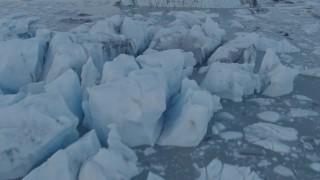 AK0001_0285 - 4K stock footage aerial video flying low over ice chunks in small lake near glacier, Knik Glacier, Alaska