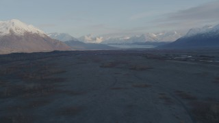 AK0001_0288 - 4K stock footage aerial video flying over river valley, approaching two parked planes, Knik River Valley, Alaska