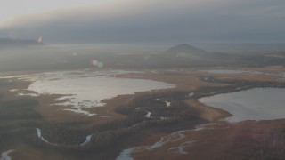 AK0001_0290 - 4K stock footage aerial video flying by three lakes with a river winding between them, Jim Lake, Alaska