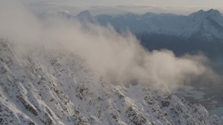 AK0001_0296 - 4K stock footage aerial video snowy slopes, clouds, Knik River Valley, Knik Glacier, Chugach Mountains, Alaska