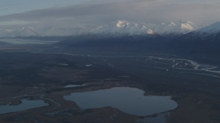 AK0001_0297 - 4K stock footage aerial video flying by lakes and rivers, bordered by Chugach Mountains, Knik River Valley, Alaska