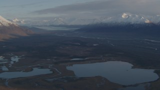 AK0001_0298 - 4K stock footage aerial video flyby lakes and rivers, bordered by Chugach Mountains, Knik River Valley, Alaska