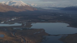 AK0001_0299 - 4K stock footage aerial video flying over lakes and rivers, tilt up to reveal Knik River Valley, Alaska