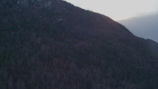 AK0001_0315 - 4K stock footage aerial video a wooded mountain slope, Chugach Mountains, Alaska, twilight