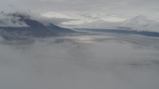 AK0001_0354 - 4K stock footage aerial video descending through clouds, approach Turnagain Arm of the Cook Inlet, Alaska