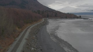 AK0001_0357 - 4K stock footage aerial video follow railroad tracks along shore of Turnagain Arm of the Cook Inlet, Alaska