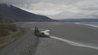 AK0001_0360 - 4K stock footage aerial video railroad tracks along foothills bordering Turnagain Arm of the Cook Inlet, Alaska