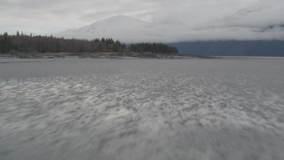 AK0001_0363 - 4K stock footage aerial video fly low over water, rocky peninsula, Turnagain Arm of the Cook Inlet, Alaska