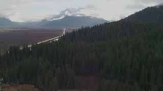 AK0001_0379 - 4K stock footage aerial video approaching wooded foothills, Kenai Mountains, Alaska